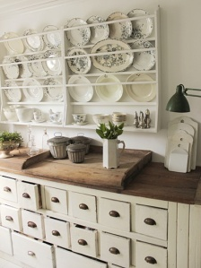 I love the chest, the wood countertop + the industrial lamp.  K.M.Y.