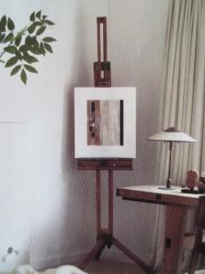 But she + I display artwork on a vintage easel!