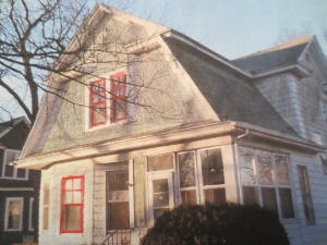 Medium gray + darker gray + white trim + red window sashes.
