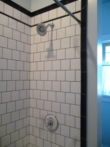 Our cheapie white tiles, tricked out with dark grout, in our bathroom.