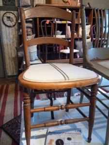 Still in our Frenchie phase. I love this chair's simple ladderback design!
