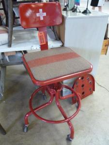Loved this industrial stool with its Swiss Army blanket upholstery + Swiss cross!