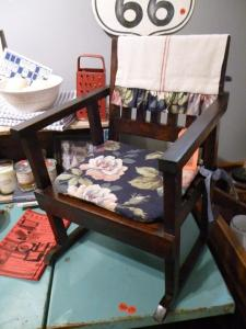 I love the vintage floral fabric  used on this child's rocker!