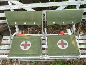 How sassy are these stadium seats? I used genuine Army tent fabric + vintage buttons!