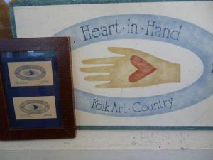 heart in hand signage