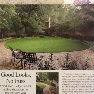round lawn with brick patio