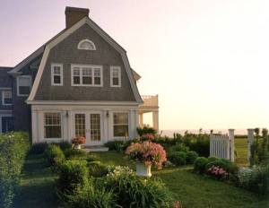 dutch colonial with gray shingle 2nd story