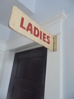 powder room door with ladies sign two