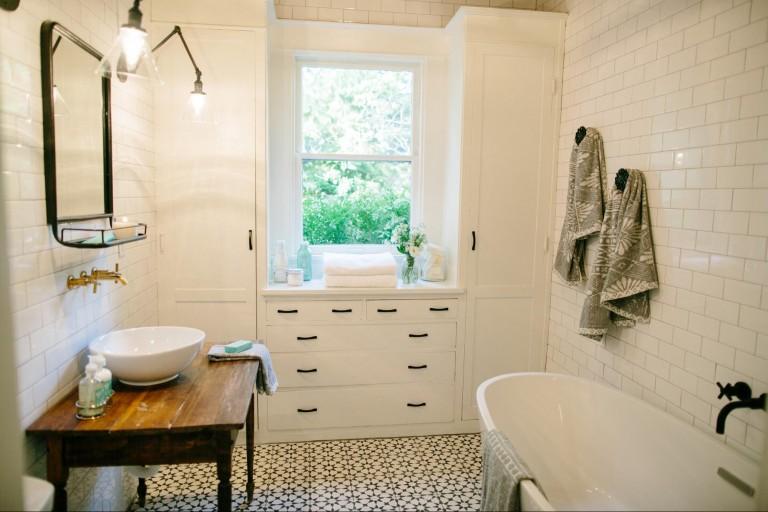 Dueling tile artwork on fixer upper redbird for Best bathrooms on fixer upper