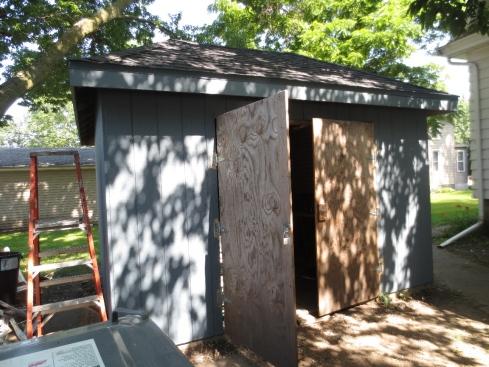 garden shed blue with open door