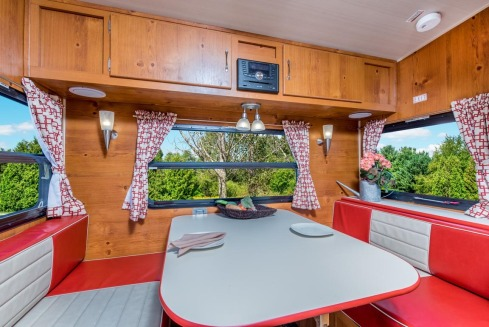 trailer-vintage-cruiser-red-white-dinette-with-knotty-pine-paneling