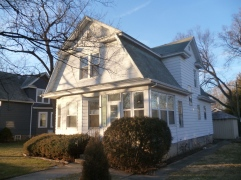 dutch colonial before with shrubs