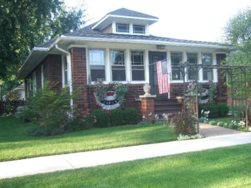 bungalow front with flags