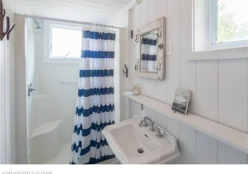 maine house bathroom shelf and striped shower curtain