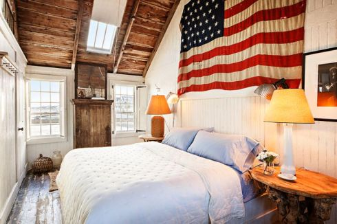 wharf house bedroom with flag