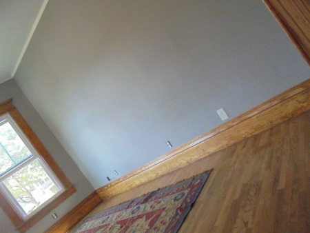 living room empty with gray walls and my rug
