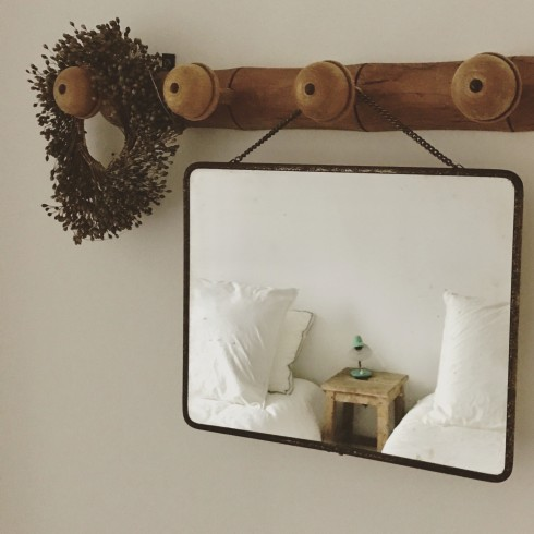french lessons -- mirror on french peg rack