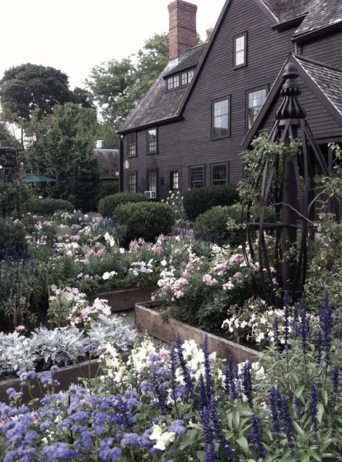 cape cod of black with gardens