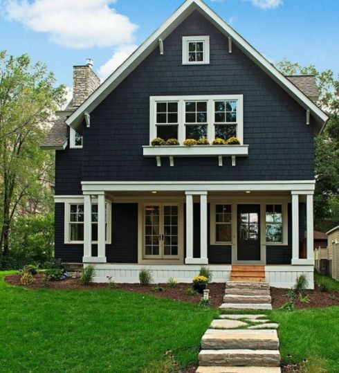 cape cod of black with twin porch posts