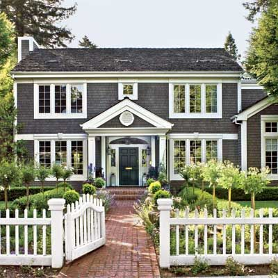 cape cod with black with white fence